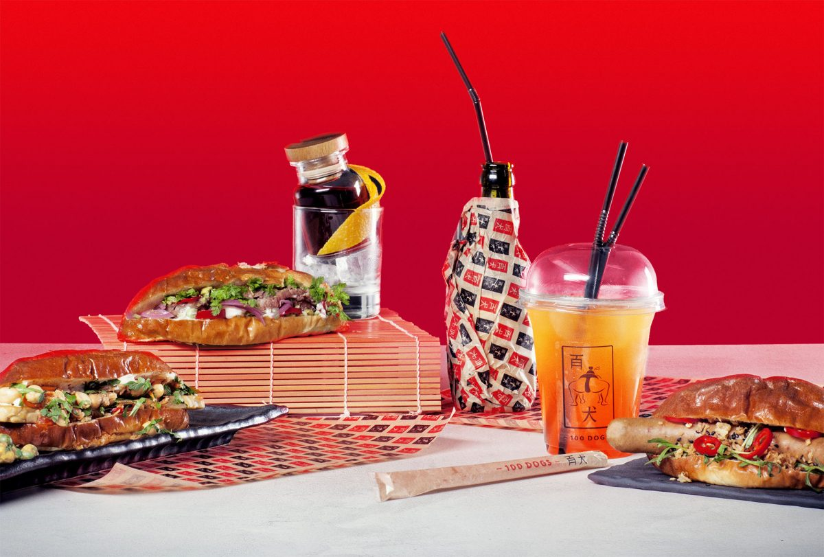 Colourful asian foods and drinks with a bright red background